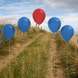 Balloons above sand dunes — Stock Photo #39194465