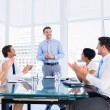 Executives clapping around conference table — Stock Photo #39194723