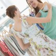 Young women shopping in clothes store — Stock Photo #39195389