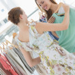 Stock Photo: Young women shopping in clothes store