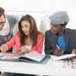 Stock Photo: Fashion designers discussing designs