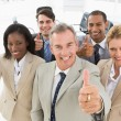 Diverse close business team smiling up at camera giving thumbs u — Stock Photo