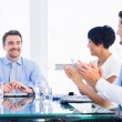 Executives clapping around conference table — Stock Photo #39195707