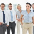 Confident smiling business team in office — Stock Photo #39195797