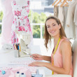 Portrait of a female fashion designer working on fabrics — Stock Photo