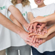 Mid section of volunteers with hands together — Stock Photo