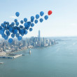 Stock Photo: Many colourful balloons above coast