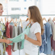 Women shopping in clothes store — ストック写真