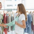 Women shopping in clothes store — Stock Photo
