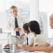 Business manager talking to staff during meeting — Stock Photo #39196983