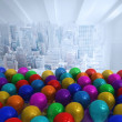 Many colourful balloons in room with city scene — Stock Photo