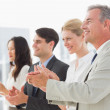 Business team standing in a line applauding — Stock Photo