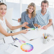 Stock Photo: Group of artists working on designs