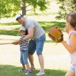 Family playing baseball in the park — Stock Photo #39197609