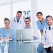 Happy medical team using laptop together — Stock Photo