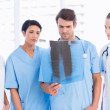 Group of doctors and surgeons examining x-ray — Stock Photo #39197887