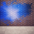 Stock Photo: Splash on wall revealing blue light