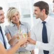 Business team toasting with champagne in office — Stock Photo