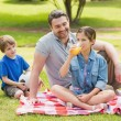 Father with kids in the park — Stock Photo
