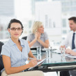 Businesswoman with colleagues discussing in office — Stock Photo #39198577