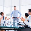Executives clapping around conference table — Stock Photo #39198677