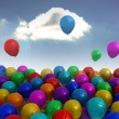 Stock Photo: Many colourful balloons sky background