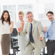 Stock Photo: Business team cheering at camera