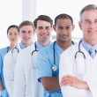 Doctors standing in a row at hospital — Stock Photo