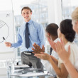 Stock Photo: Colleagues applauding businessmafter presentation