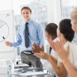 图库照片: Colleagues applauding businessmafter presentation
