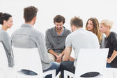 Group therapy in session sitting in a circle — Stock Photo