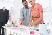 Fashion designers at work in bright studio — Stockfoto