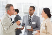 Business people talking and having coffee at a conference — Stock Photo