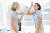 Side view of two businesswomen fighting — Stock Photo
