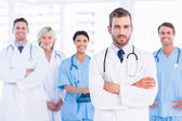 Confident happy group of doctors at medical office — Stock Photo