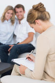 Couple in meeting with a financial adviser — Stock Photo