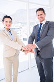 Cheerful business colleagues joining hands together — Stock Photo