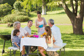 Extended family dining at outdoor table — Stock Photo