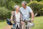 Senior couple on cycle ride at the park — Stockfoto