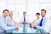 Executives sitting around conference table — Stock Photo