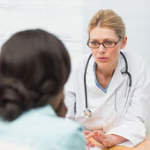 Concerned doctor talking to her patient — Stock Photo