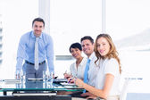 Executives around conference table in office — Stock Photo