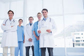 Young doctors standing together at hospital — Stock Photo