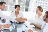 Executives shaking hands during a business meeting — Stockfoto