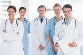 Doctors standing together at hospital — Stock Photo
