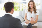 Smiling woman in meeting with a financial adviser — Stock Photo