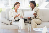 Businesswomen planning together on the sofa and laughing — Stock Photo