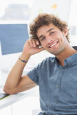 Smiling casual young man in office — Stock Photo