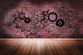 Cogs and wheels on brick wall — 图库照片