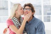 Woman kissing man on his cheek — Stock Photo